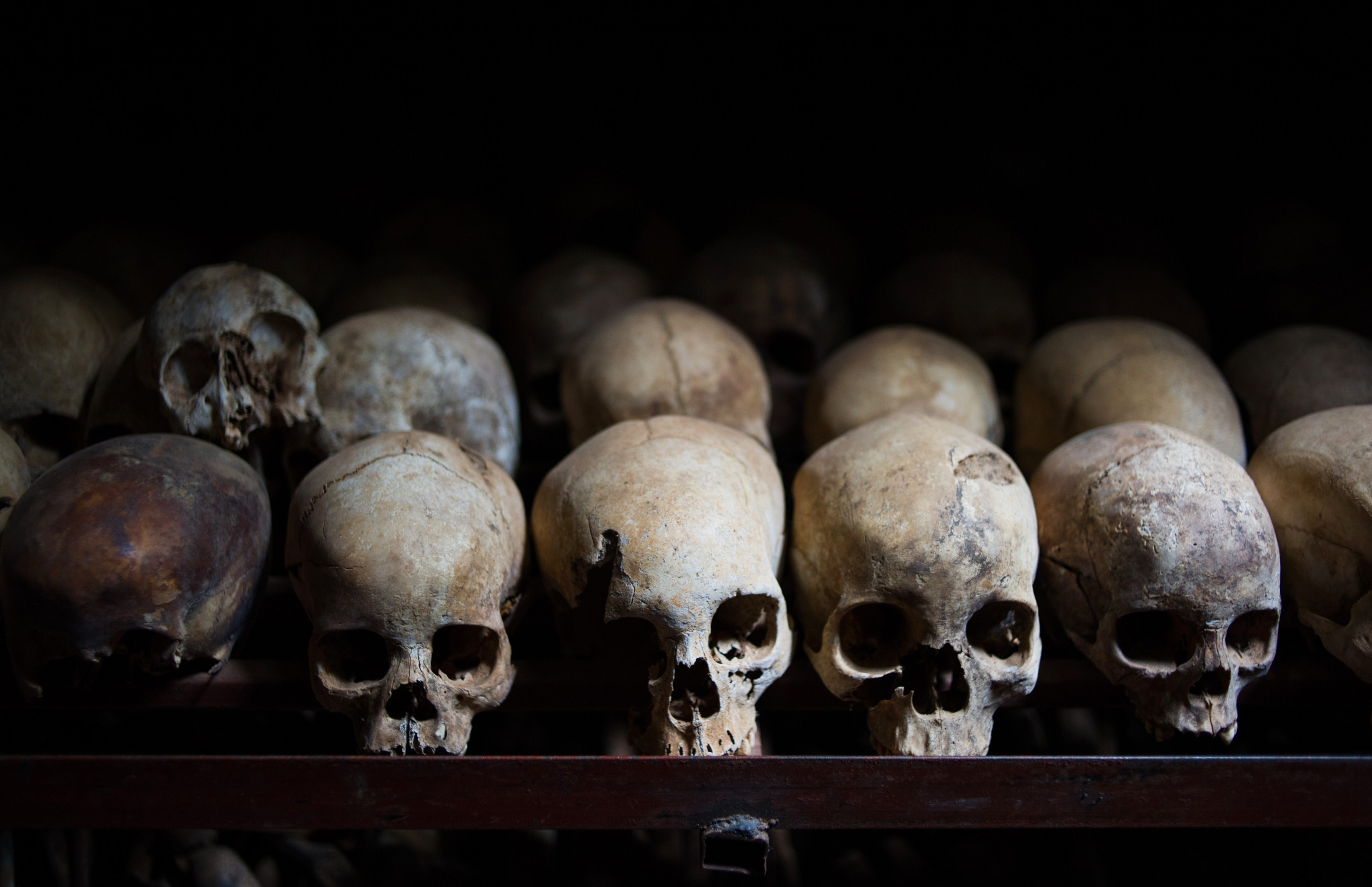 TO GO WITH AFP STORY BY HANNAH MCNEISH This photo taken on March 12, 2014, shows the skulls of victims killed during the Rwandan genocide, laid out in the Nyamata Church in Nyamata, Rwanda. Nyamata and the surrounding area suffered some of the worst violence during the 1994 Genocide Against the Tutsi, with thousands of people killed in and around the church, which now stands as a memorial to the genocide.  A survey showed that 26 percent of the Rwandan population suffers from post-traumatic stress disorder, yet the country lacks the adequate mental health facilities needed to address this issue.  AFP PHOTO / PHIL MOORE        (Photo credit should read PHIL MOORE/AFP/Getty Images)